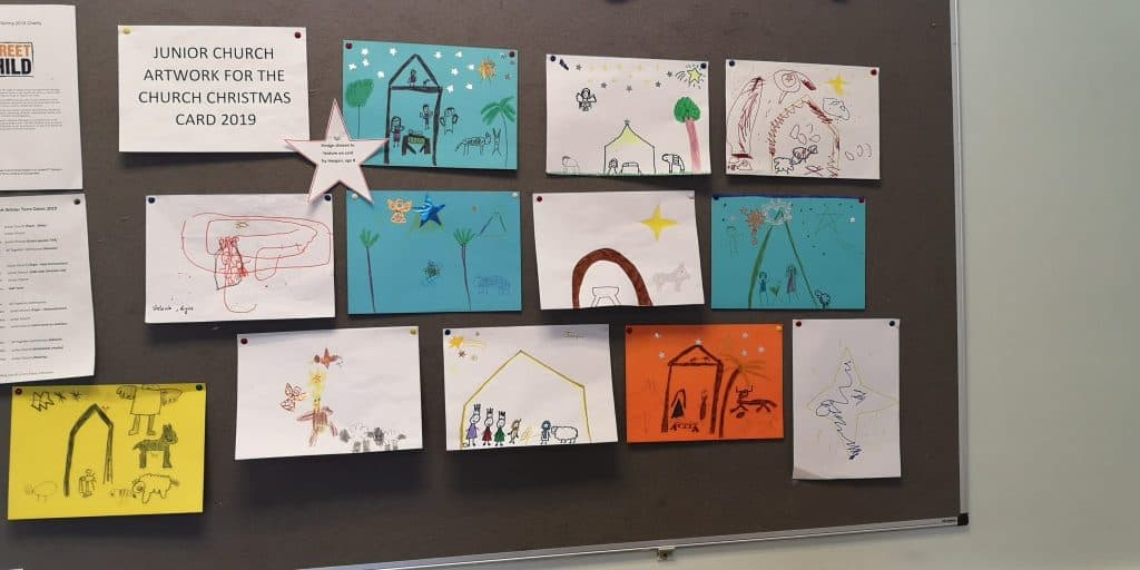 Children's designs for the front of the Christmas card